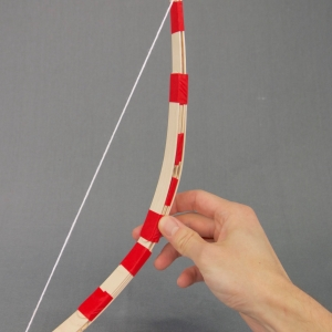 Test the strength of your DIY craft stick bow.